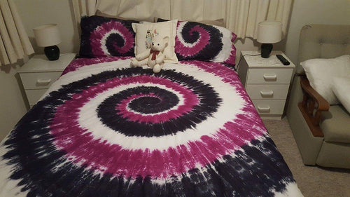 Purple, black and white Doona cover.
