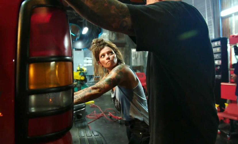 Rae Ripple working with a man in garage