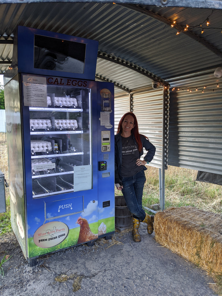 wise acre farms farmer and dovetail workwear woman at work Tiffany Holbrook and the one-of-a-kind egg vending machine