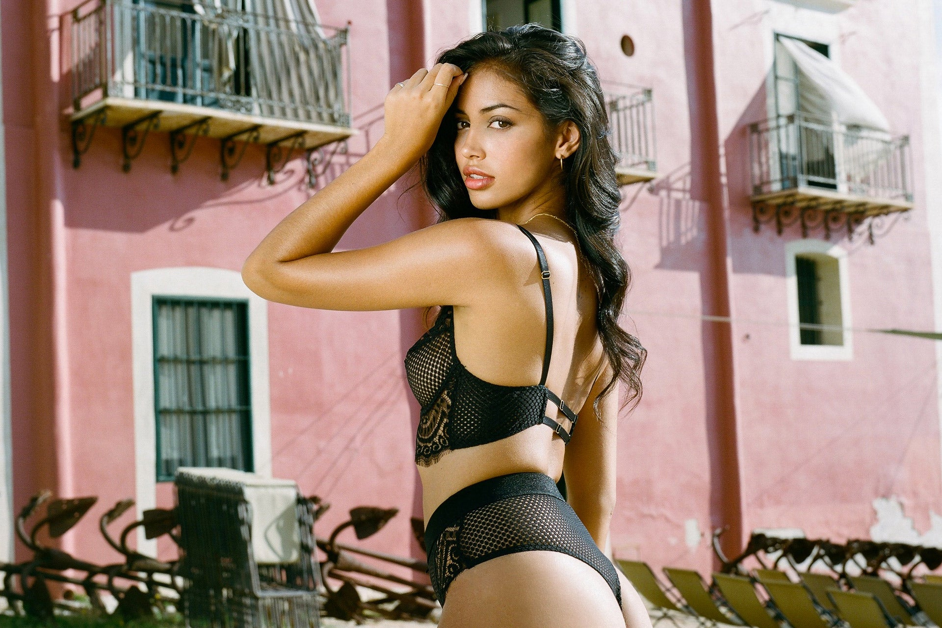 Cindy Kimberly flaunting the rear details of the Full On Glam lingerie set in Black