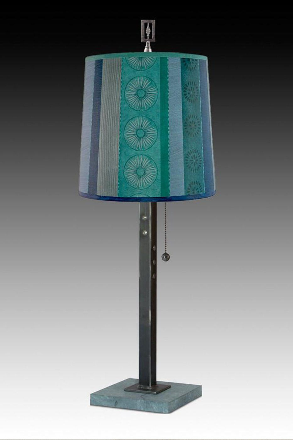 Steel Table Lamp on Marble with Medium Drum Shade in Serape Waters