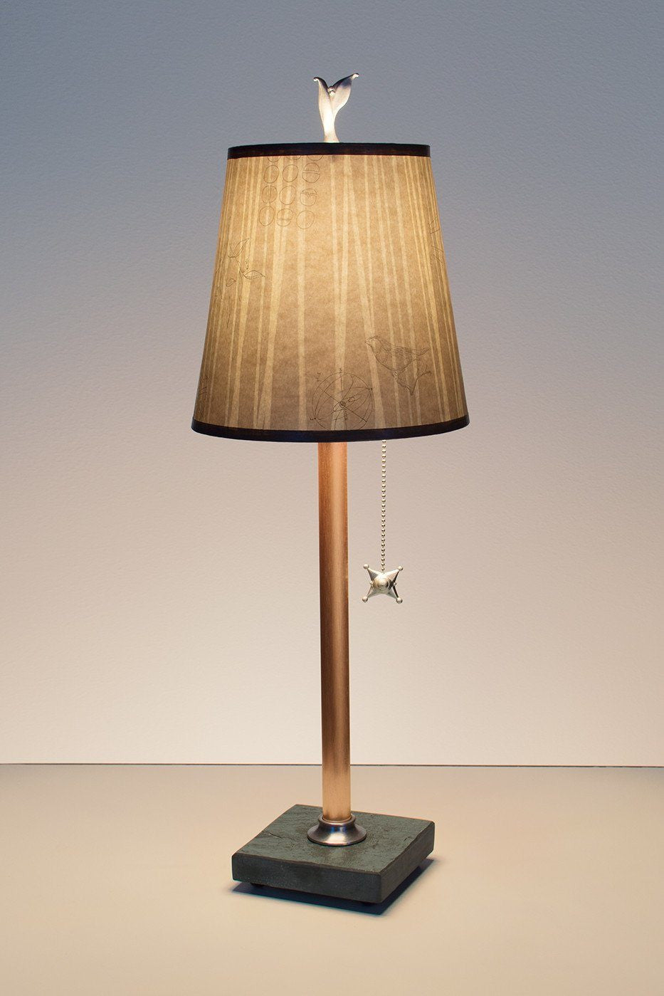 copper table lamp on vermont slate base with small drum shade in birch lit