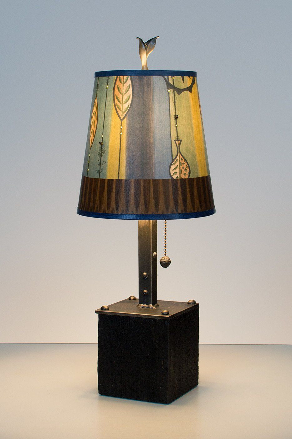 Steel table lamp on reclaimed wood with small drum shade in leaf steel table lamp on reclaimed wood with small drum shade in leaf stripe blues lit geotapseo Image collections