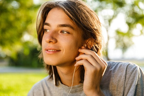 Young Man with Earbuds