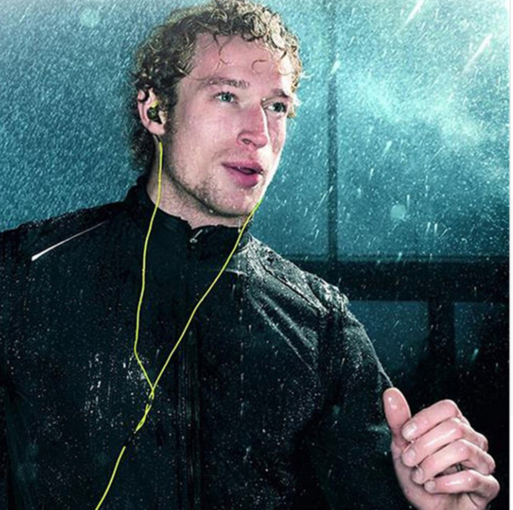 IPX5 Sweat and Water Resistant Sport Ear Hook Headphones W/ Mic - Man Running in The Rain