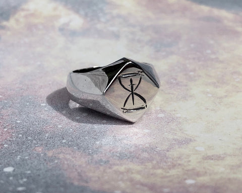 Nocturnal Graves silver signet ring on a background of flames