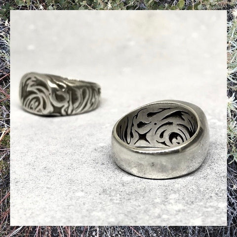 Set of silver rings with outer and inner carvings