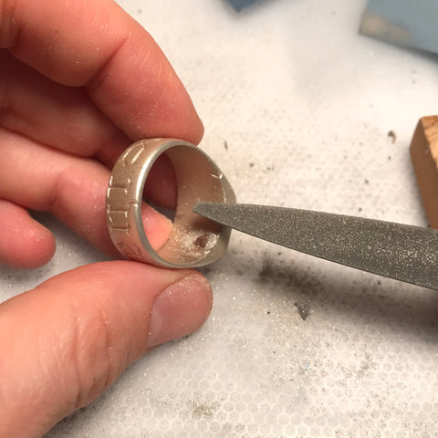 Silver signet ring with sprue filed