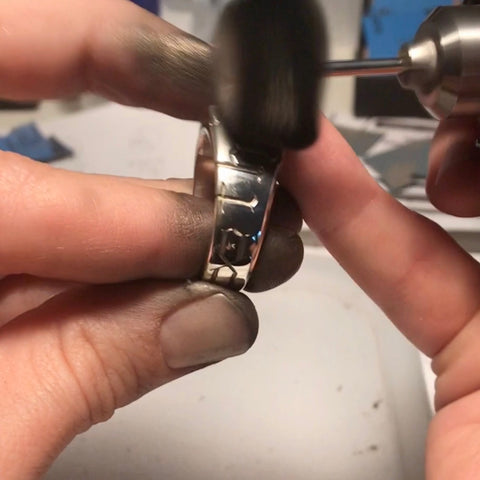 Silver signet ring being polished