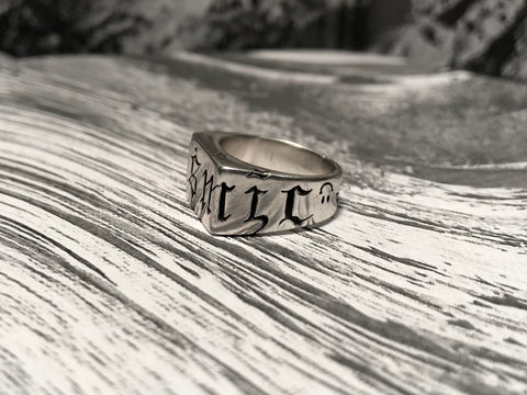 Profile view Cosmic 1ne carved silver ring