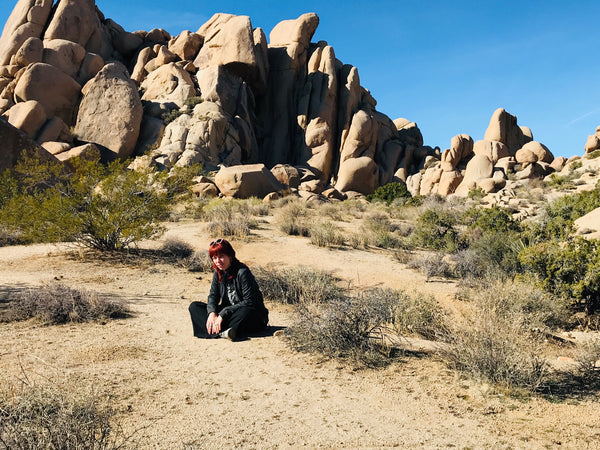 Grace Griffin sitting in Joshua Tree National Park