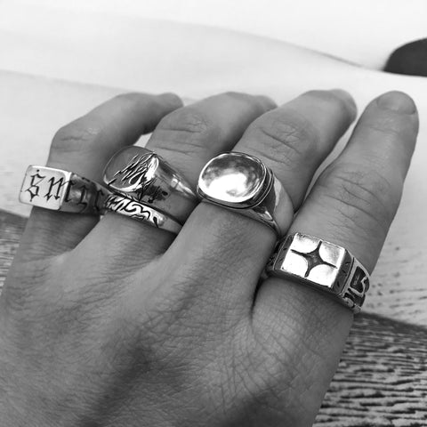 Five silver rings on fingers