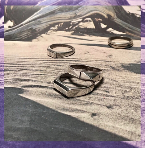 Ancíent Relíc series rings on desert background