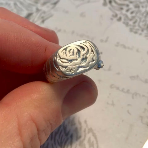 Front view Cosmic Rose raw silver signet