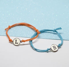 Initials on cord