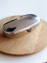 Metallic Oval Clutch Bag