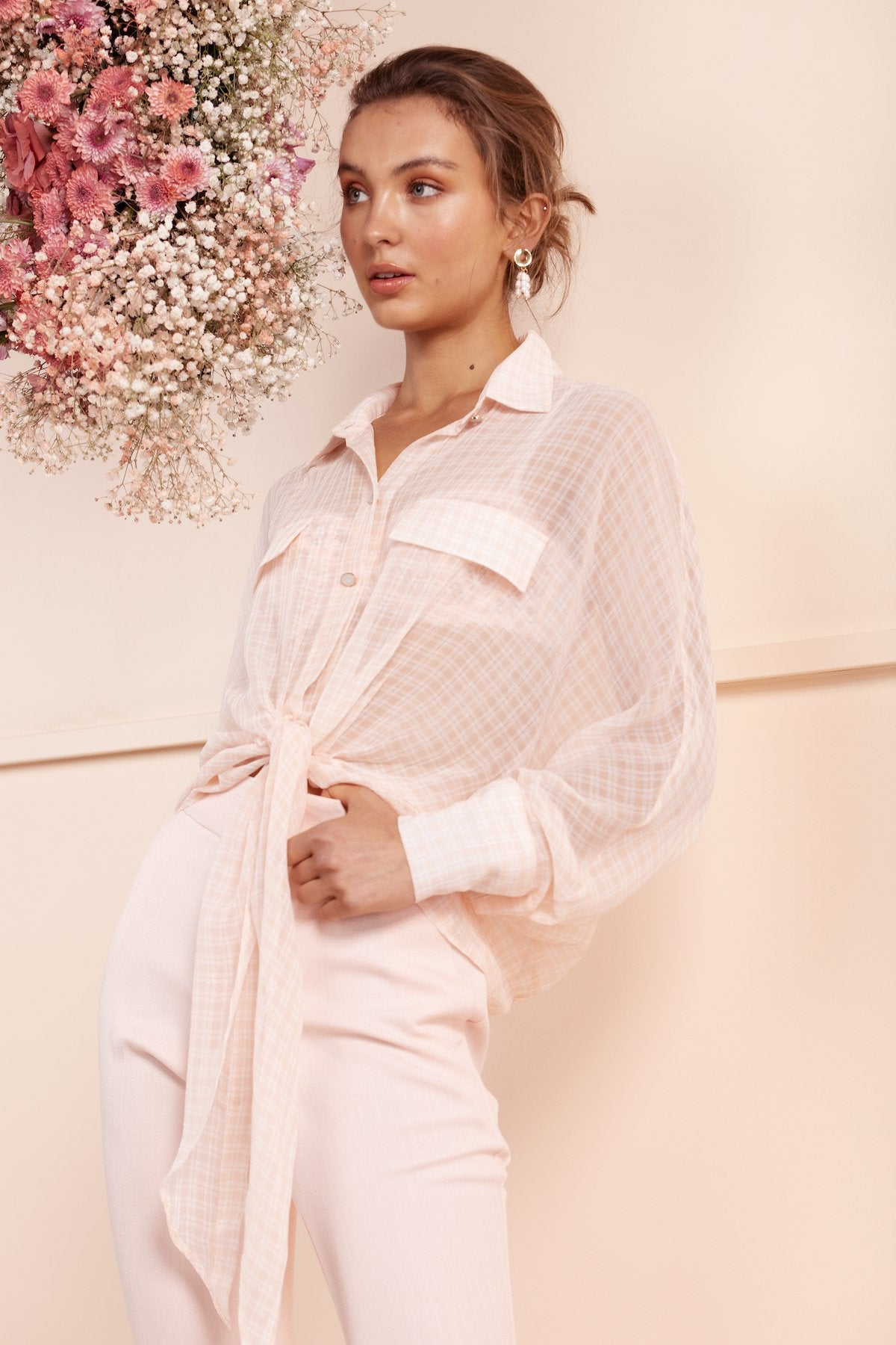 girl wearing bubish sheer pink check silk shirt