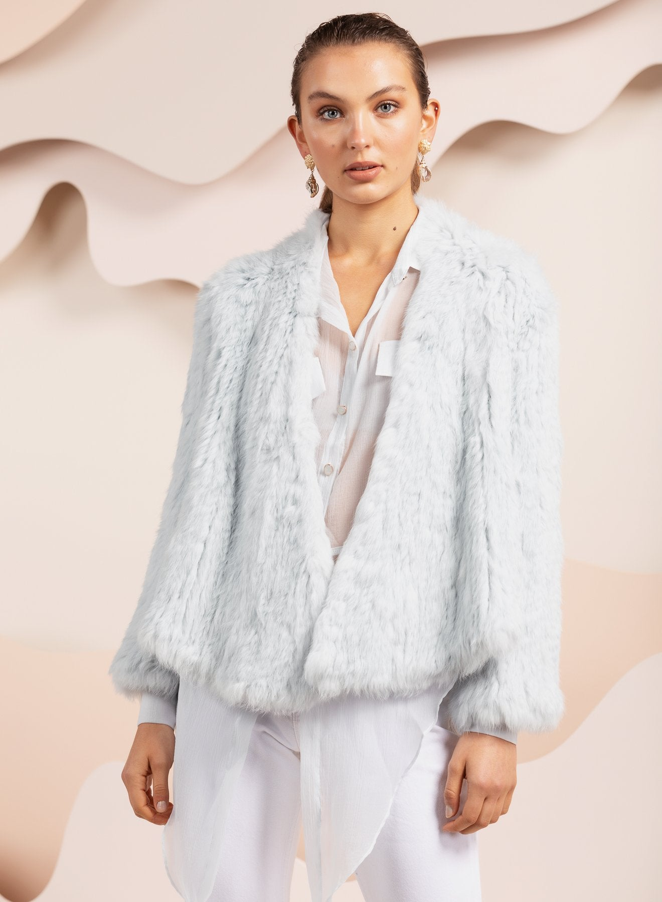 girl wearing pale blue bubish rabbit valencia fur jacket