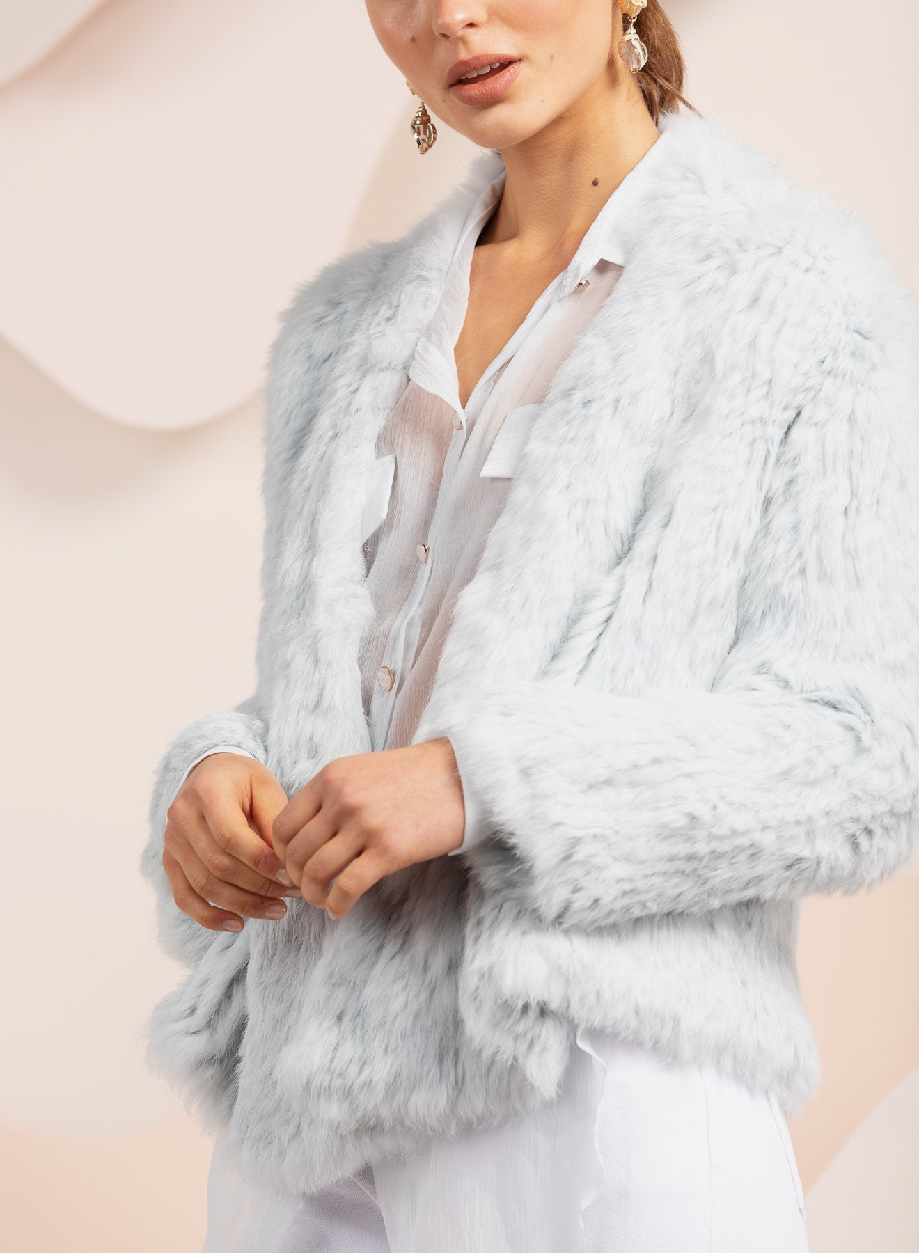 girl wearing pale blue bubish rabbit fur jacket