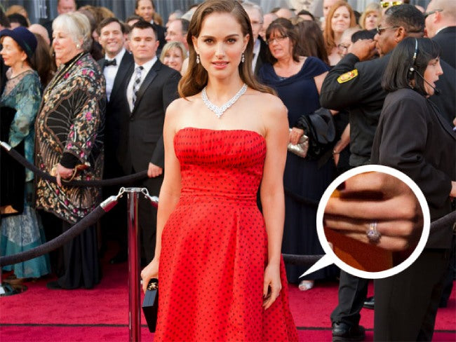 Natalie Portman wearing an eco - friendly dress and a ring
