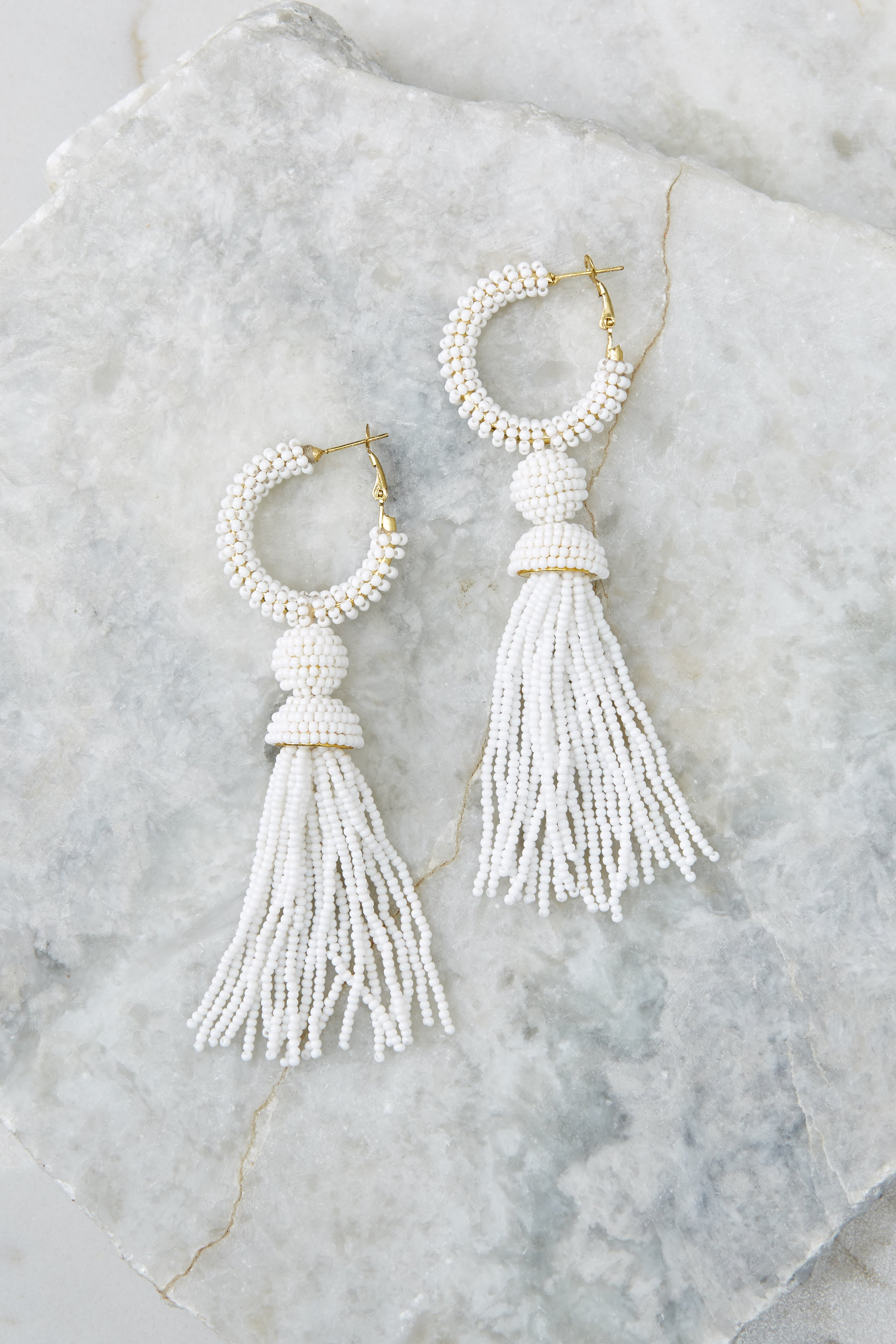 2 Fighting Silence White Beaded Tassel Earrings at reddressboutique.com