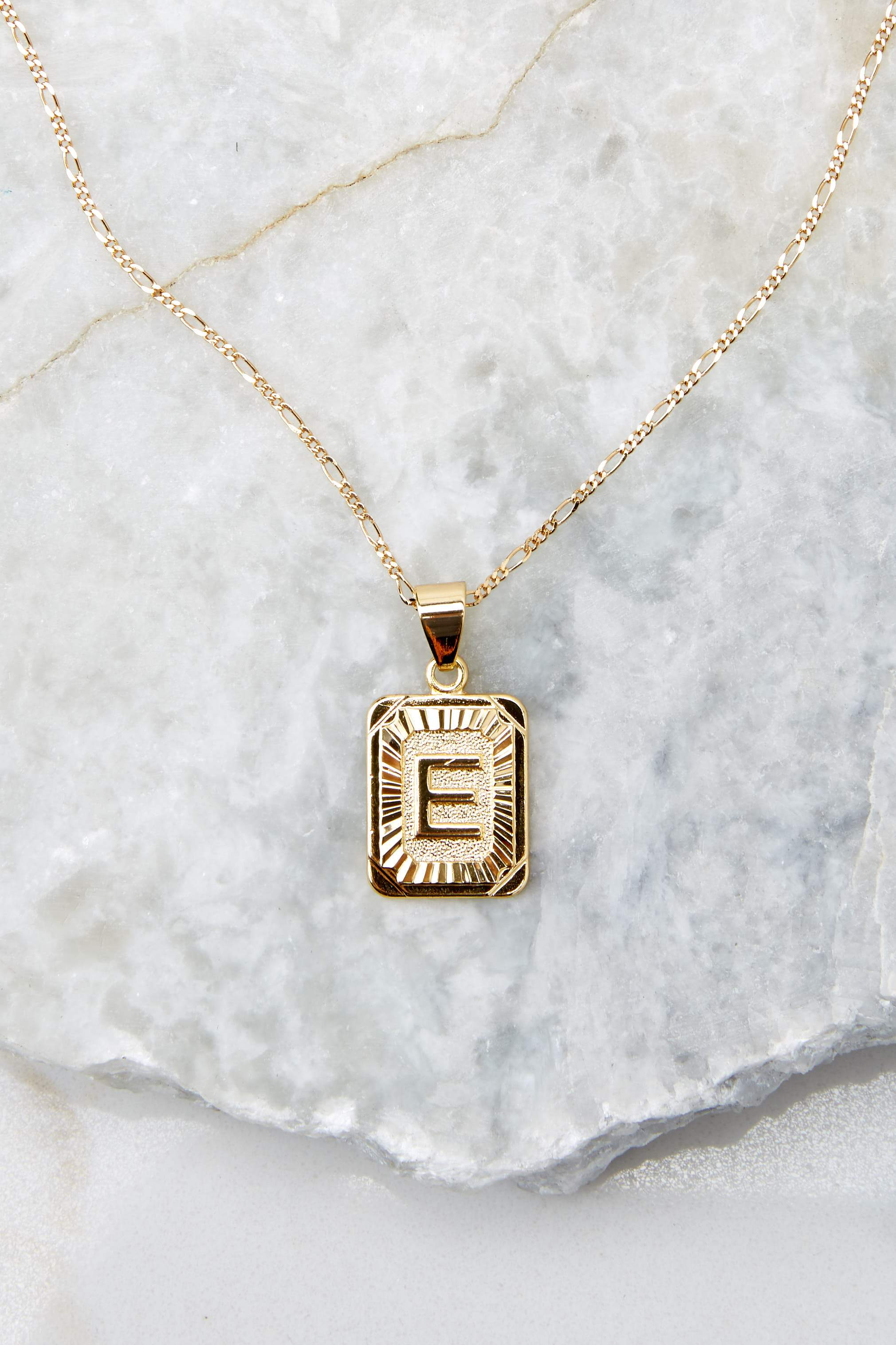 17 E Initial Card Gold Necklace at reddressboutique.com