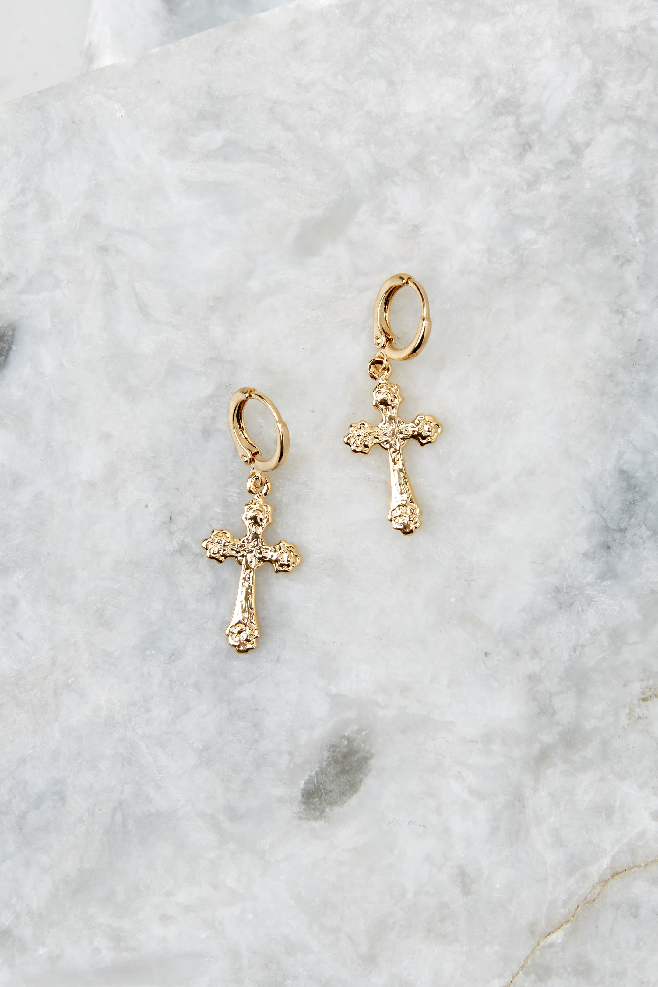 2 Faithful Gold Huggie Earrings at reddressboutique.com