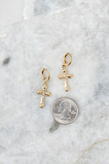 3 Faithful Gold Huggie Earrings at reddressboutique.com