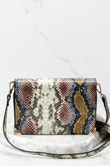 2 Read Into This Snake Print Purse at reddressboutique.com