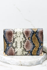 3 Read Into This Snake Print Purse at reddressboutique.com