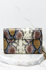 5 Read Into This Snake Print Purse at reddressboutique.com