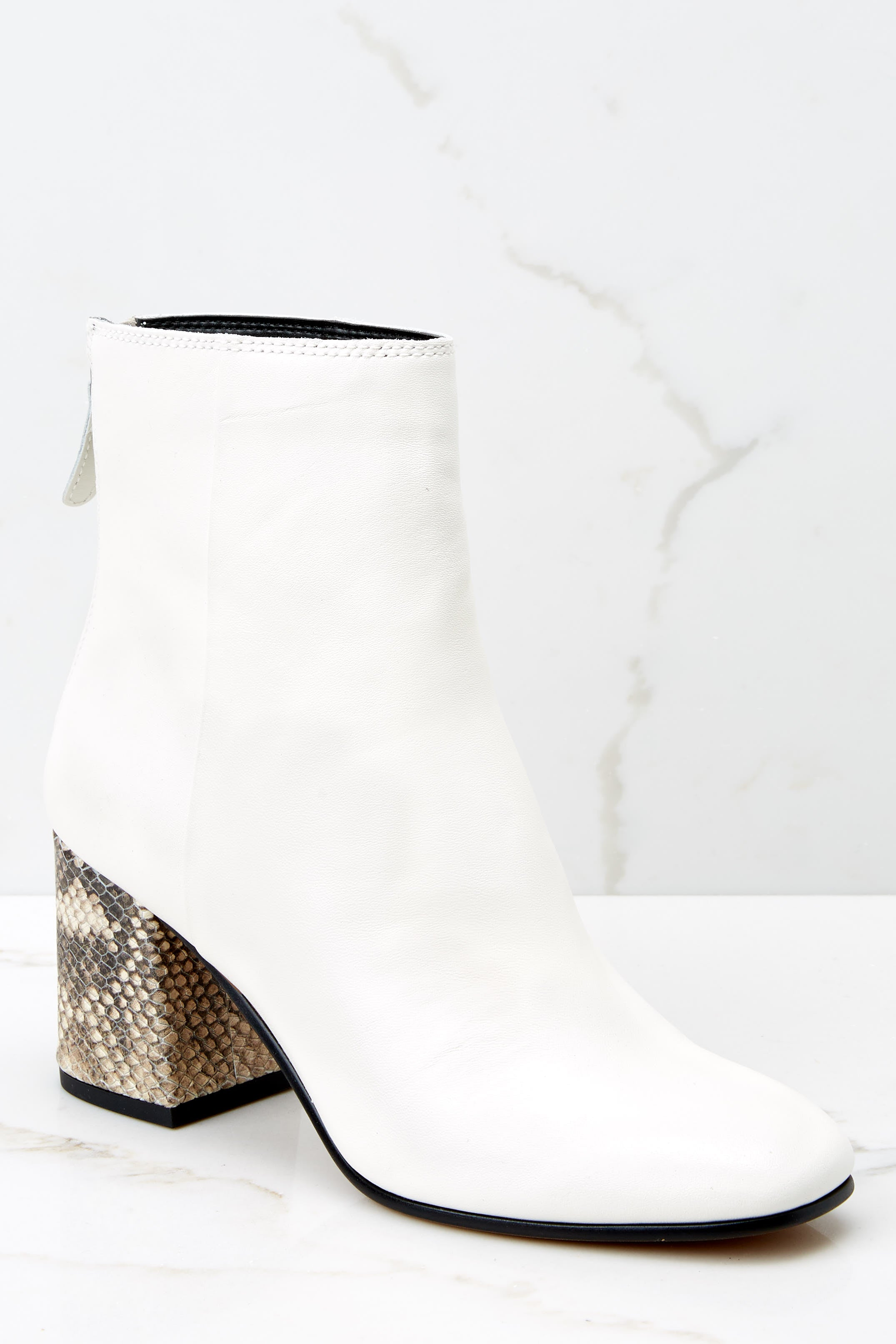 1 Vidal White Booties at reddressboutique.com