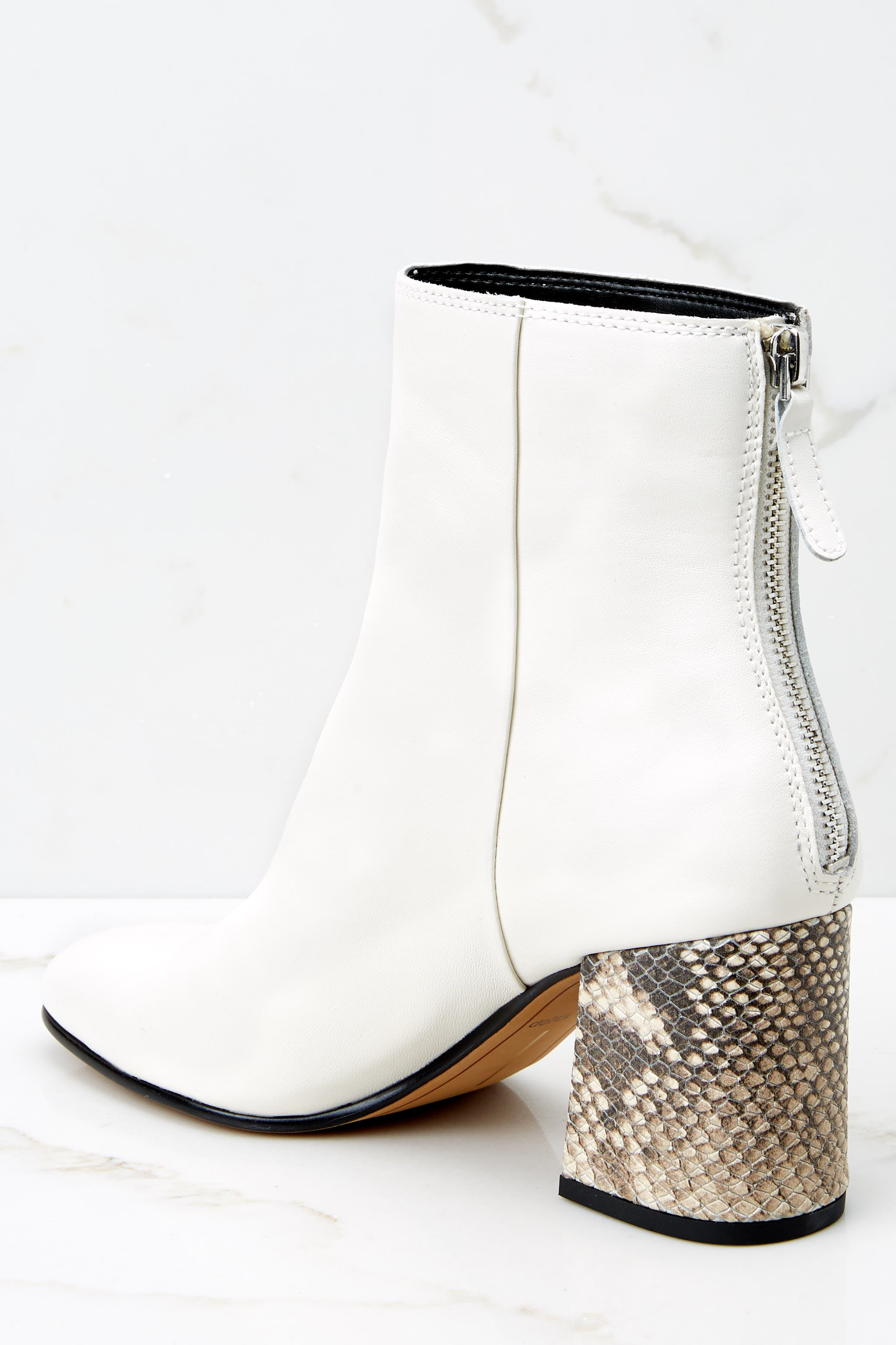 3 Vidal White Booties at reddressboutique.com