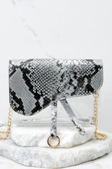 7 Everyone Will Know Snake Print Purse at reddressboutique.com