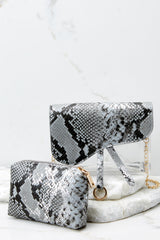8 Everyone Will Know Snake Print Purse at reddressboutique.com