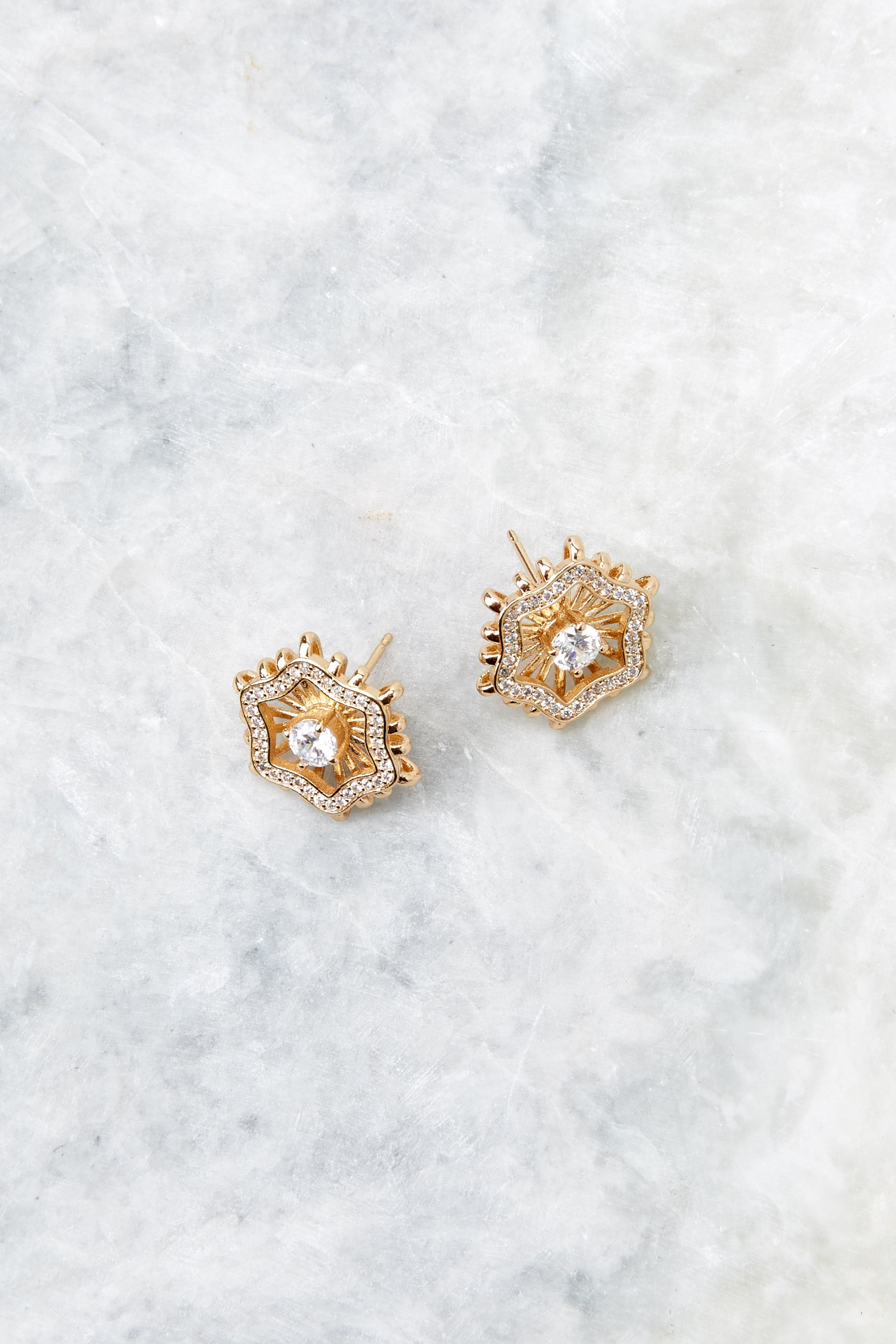2 Chloe Gold Stud Earrings at reddressboutique.com
