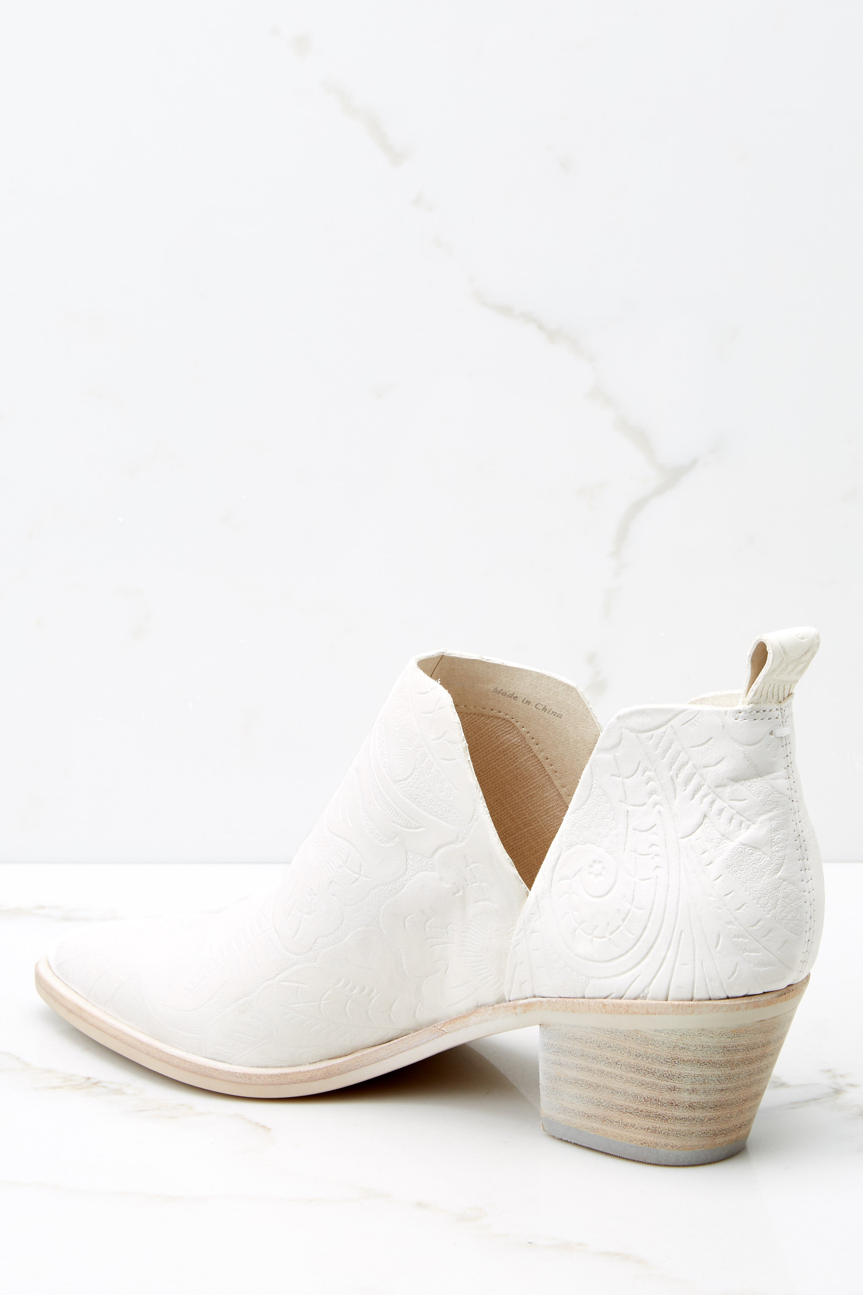 6 Sonni White Embossed Booties at reddress.com