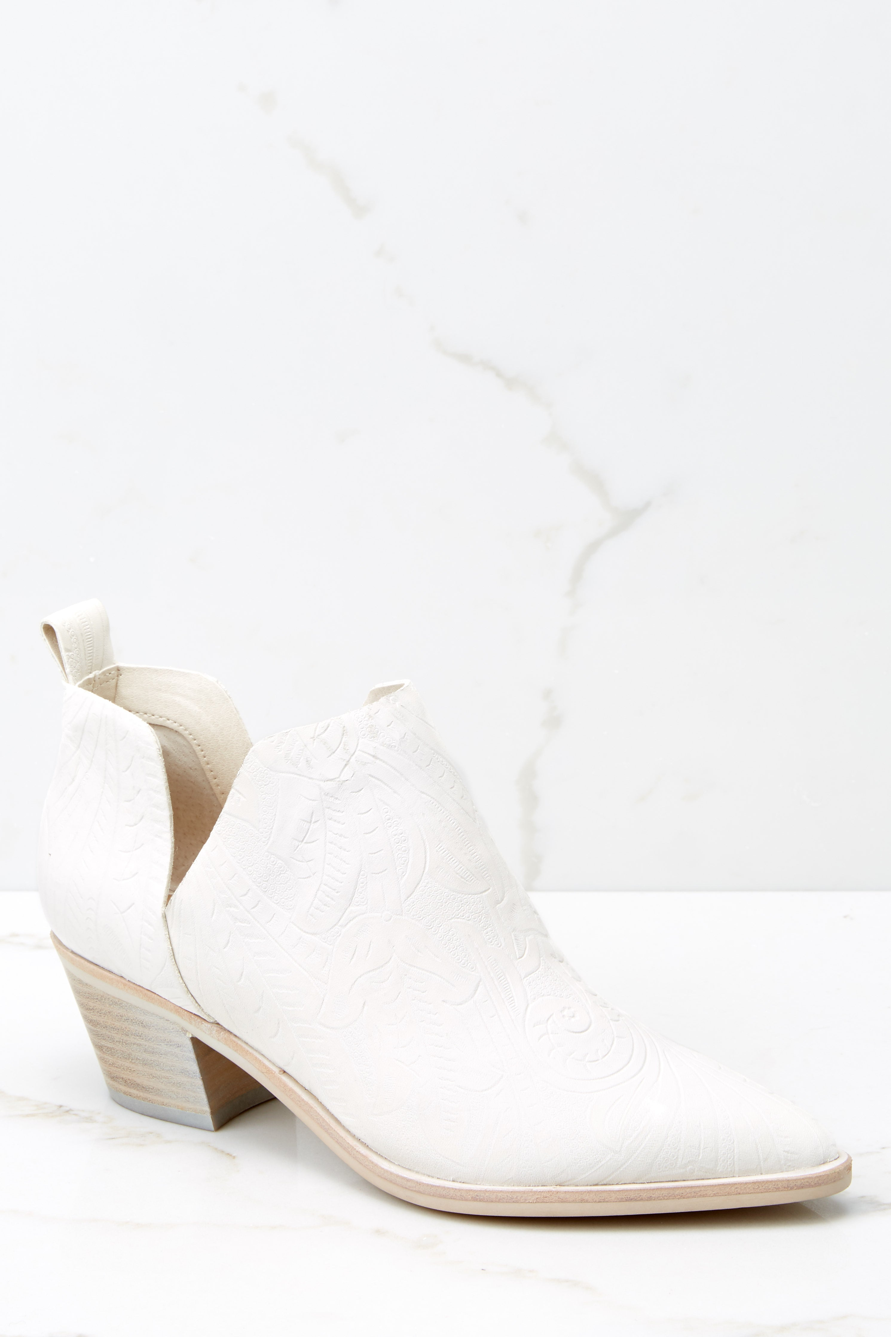 4 Sonni White Embossed Booties at reddress.com