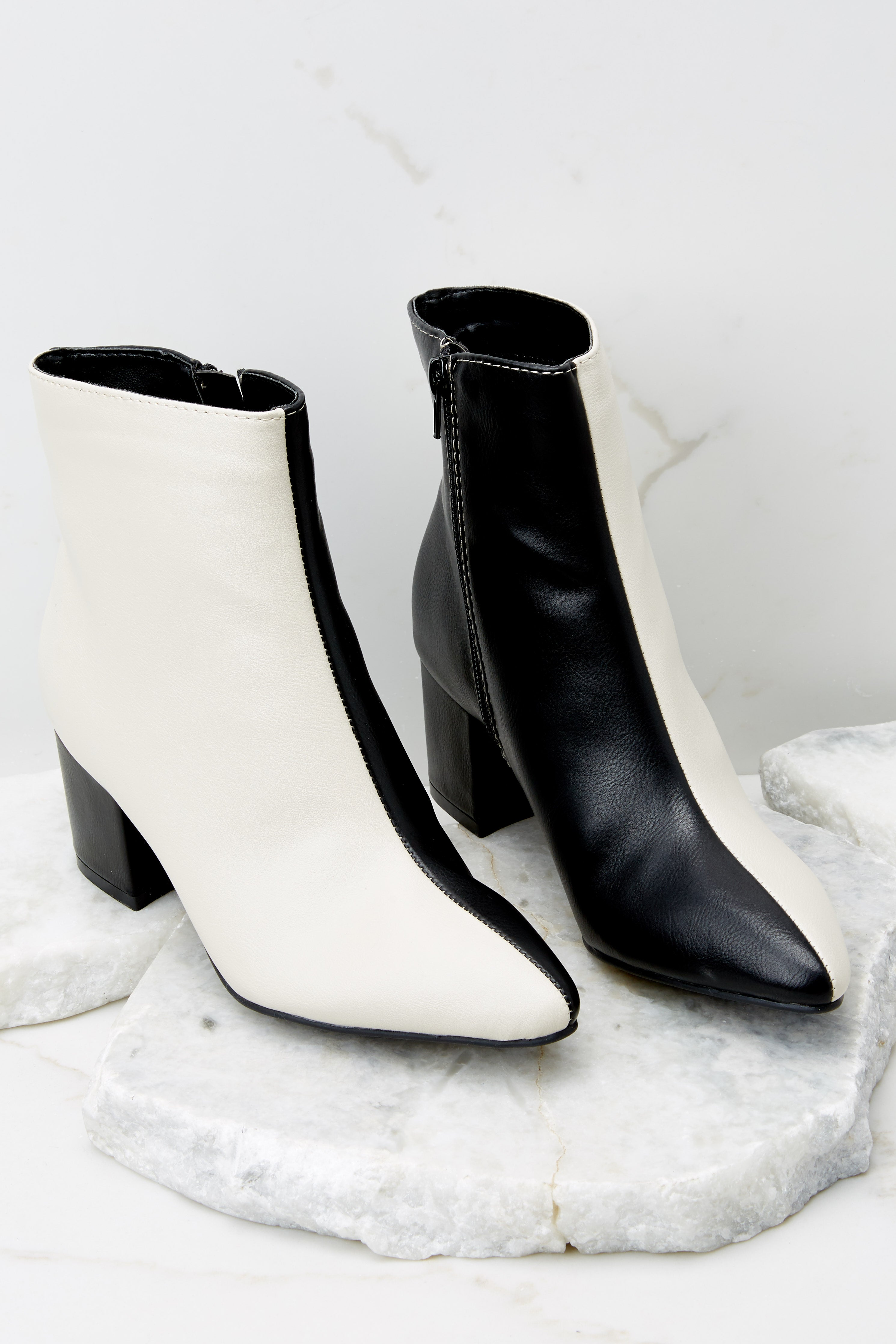 2 Split Decision Ivory And Black Ankle Booties at reddress.com