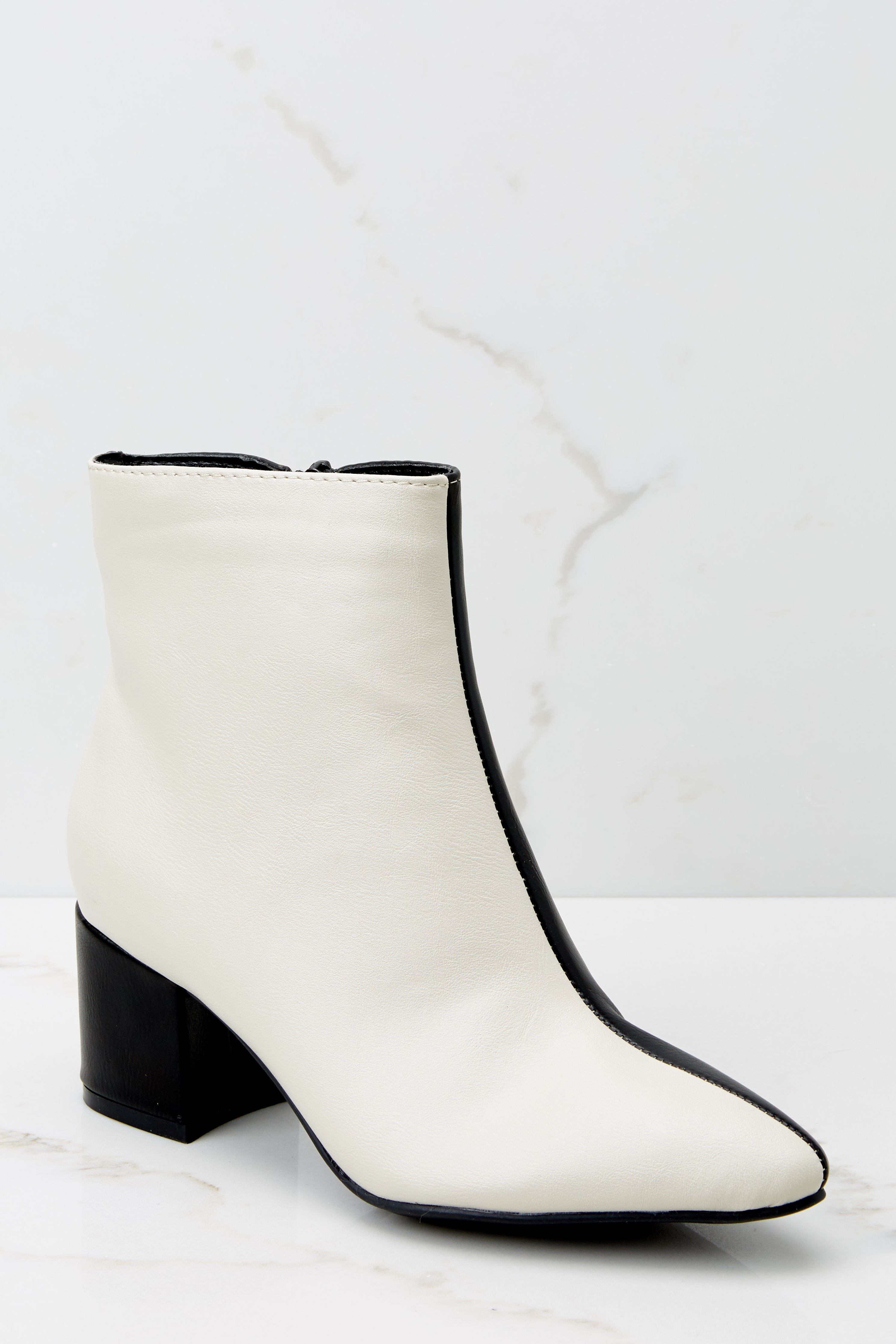 3 Split Decision Ivory And Black Ankle Booties at reddress.com