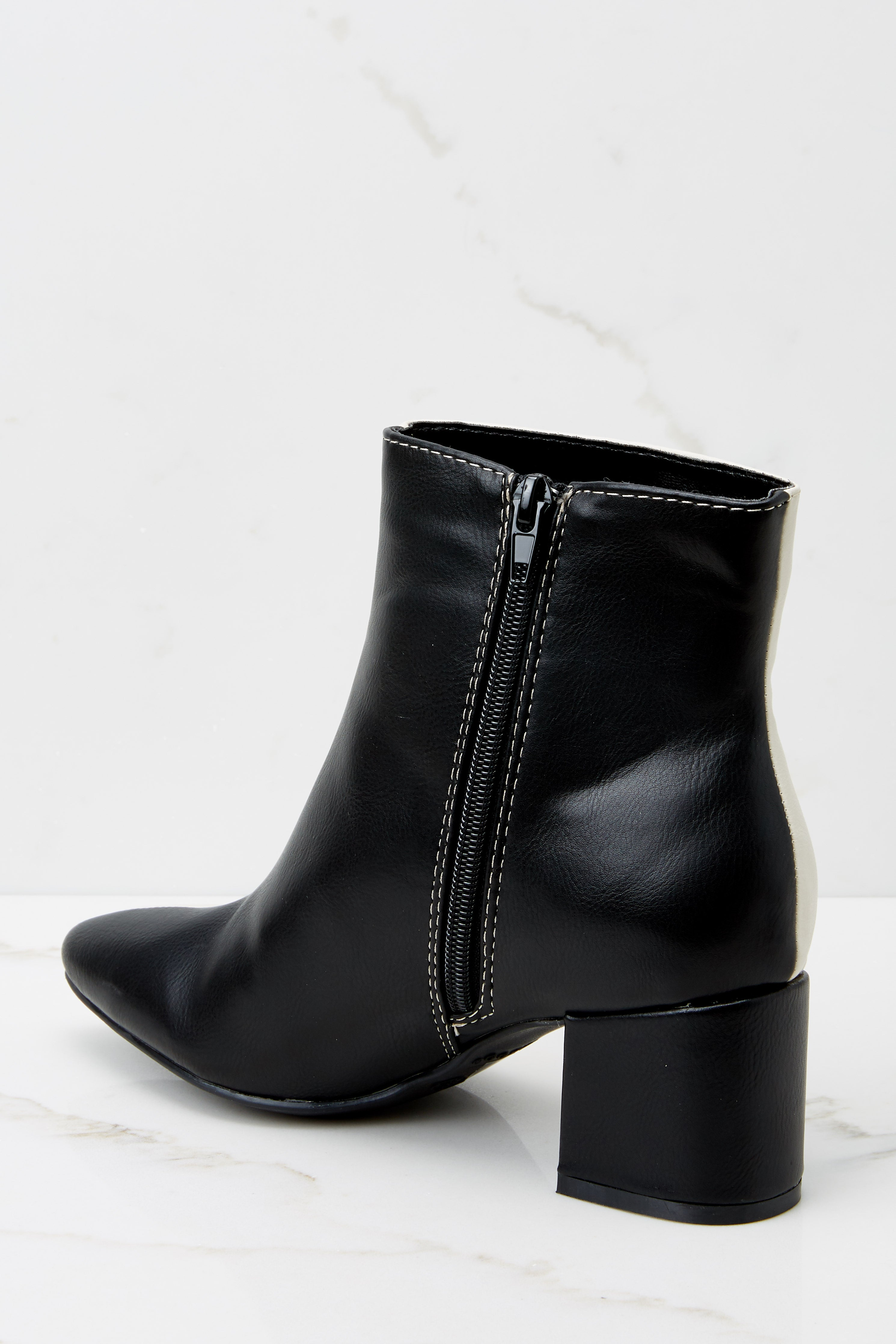 5 Split Decision Ivory And Black Ankle Booties at reddress.com