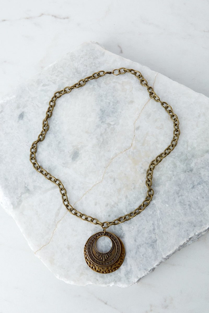 3 Raw And Rebellious Envy Me Gold Pendant Necklace at reddressboutique.com