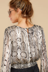 8 Sharp Feelings Taupe Snake Print Top at reddressboutique.com
