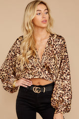 6 Wild Thing Gold Leopard Print Top at reddressboutique.com