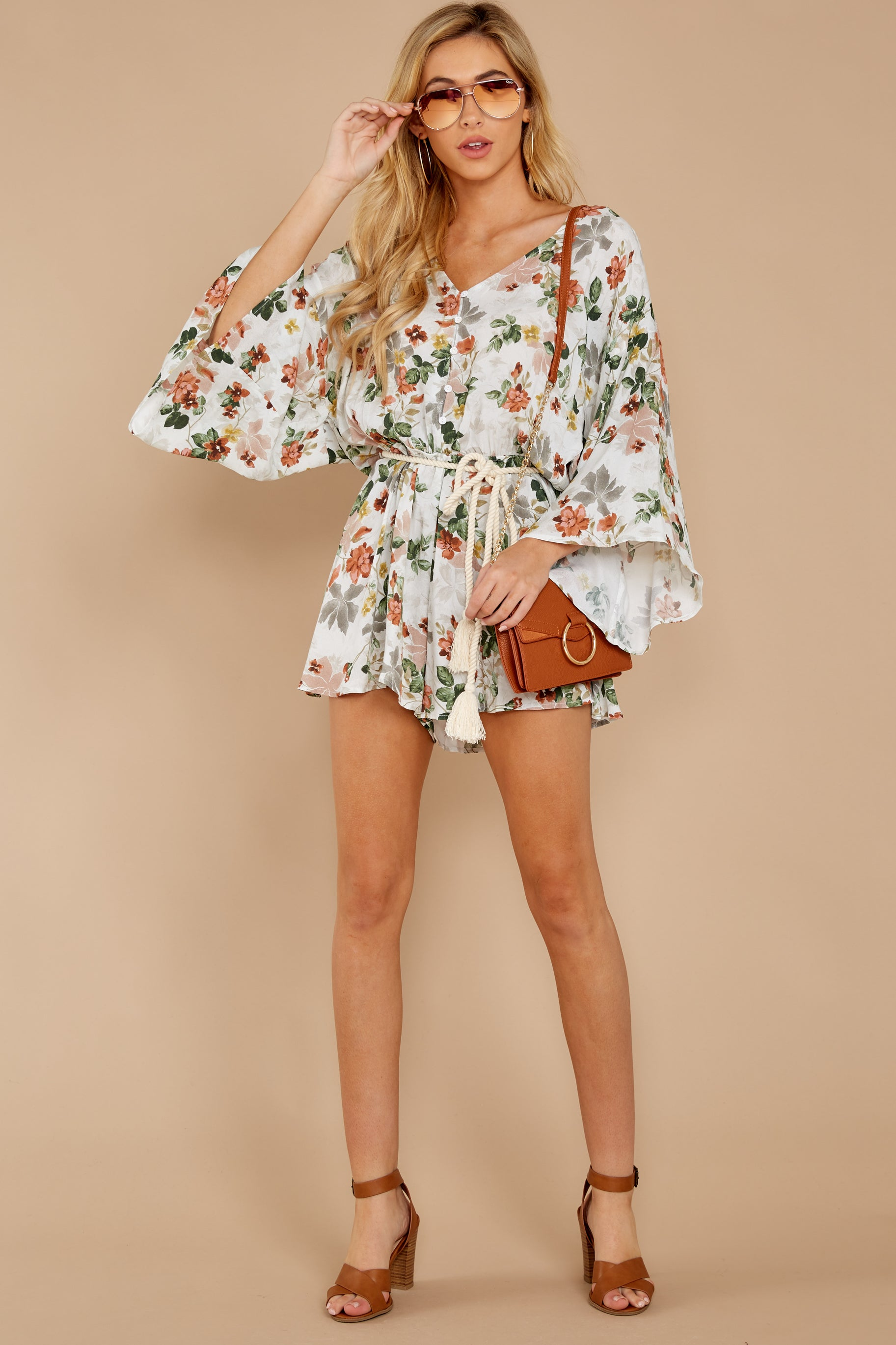 2 Edge Of A Dream Ivory Floral Print Romper at reddressboutique.com