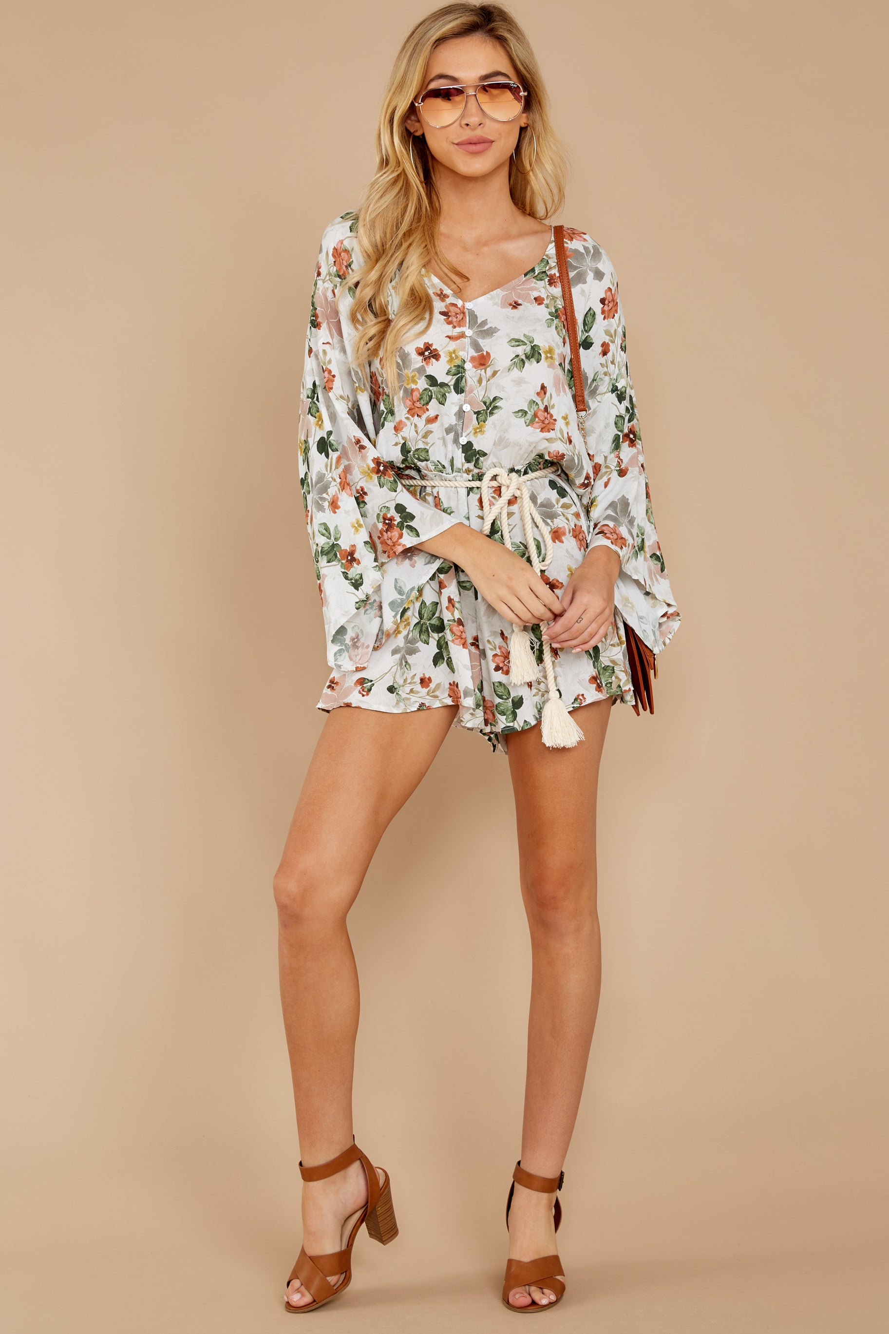 4 Edge Of A Dream Ivory Floral Print Romper at reddressboutique.com
