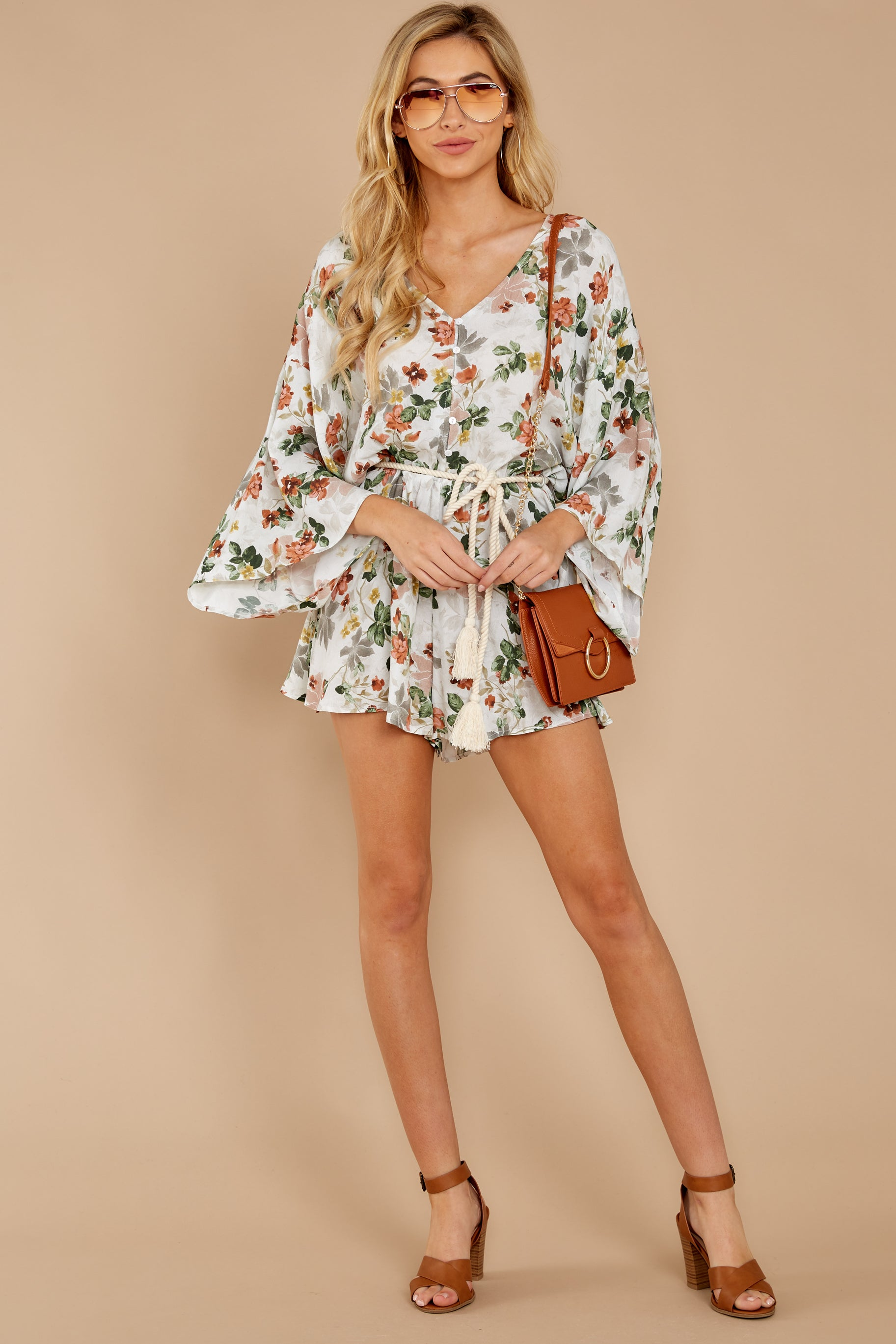 3 Edge Of A Dream Ivory Floral Print Romper at reddressboutique.com