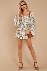 1 Edge Of A Dream Ivory Floral Print Romper at reddressboutique.com