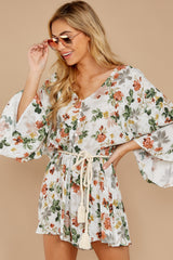 5 Edge Of A Dream Ivory Floral Print Romper at reddressboutique.com