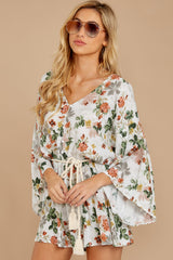 6 Edge Of A Dream Ivory Floral Print Romper at reddressboutique.com